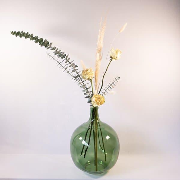green bottle vase dried eucalyptus