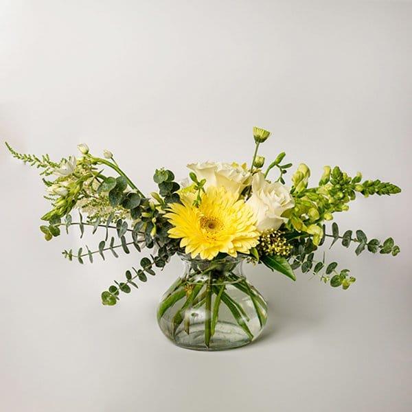 vase arrangement yellow greens glass