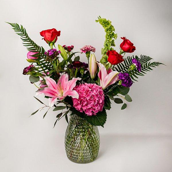 vase arrangment bright colourful pink purple large glass